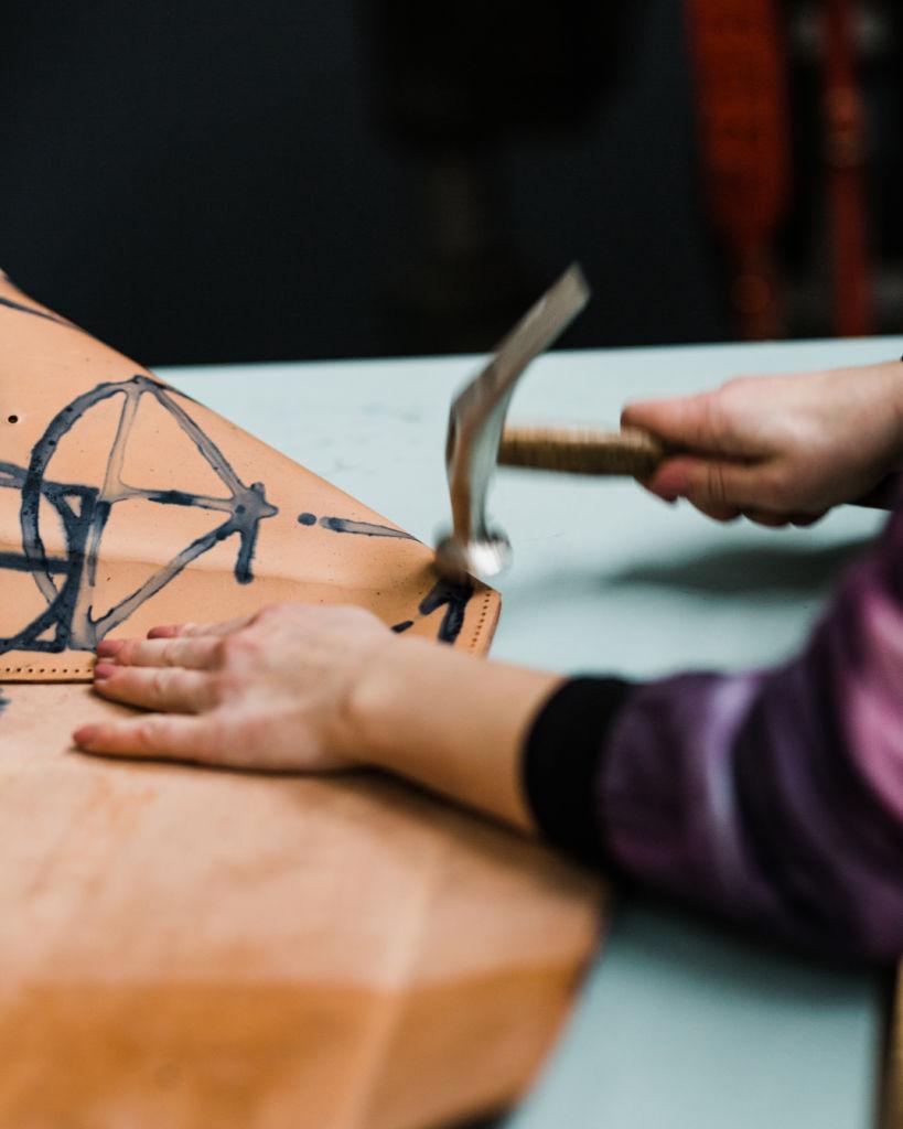 Vanessa folding an ESDE piece